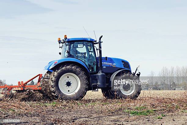 farmer on tractor - tiller stock photos and pictures