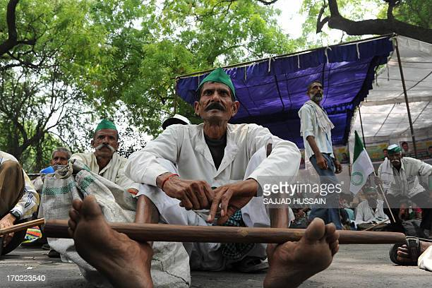 A farmer participates in a protest against the Indian goverment in New Delhi on June 9 2013 The farmers were calling for changes in the 1894 Land...