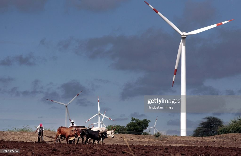 A farmer ploughing his land near Brahminwel, the area which is the site for one of the largest windmill projects started by Suzlon.