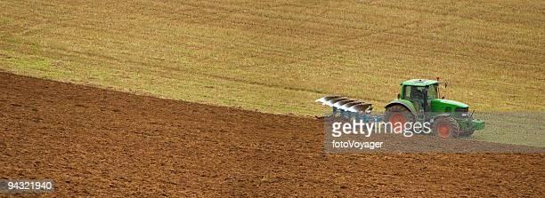 Farmer plowing panorama