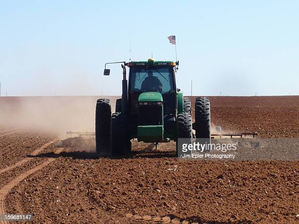 CONTENT] A farmer plows a field on a farm in Texas An patriotic American flag can be seen mounted on the equipment cab