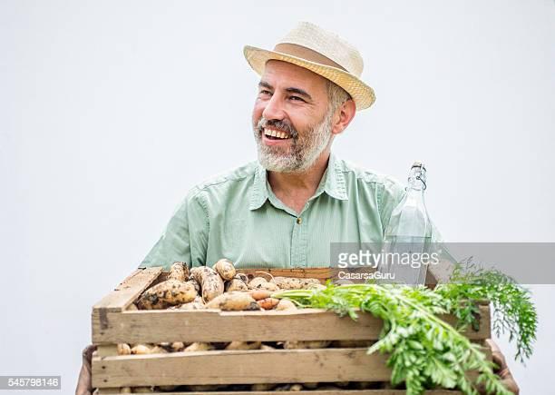 Farmer portrait holding his crops