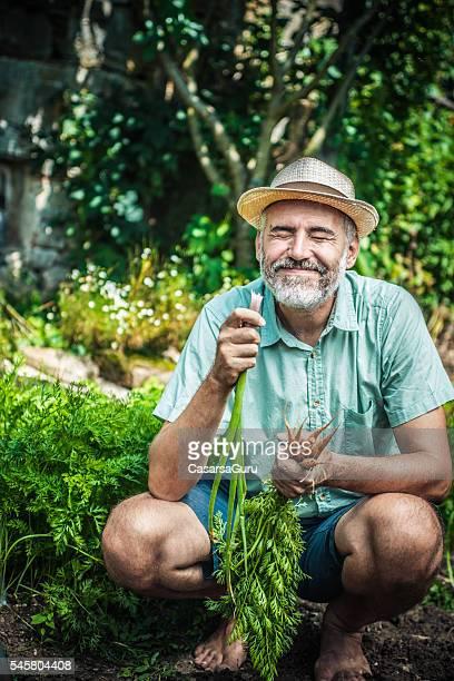 Farmer portrait in his vegetable garden