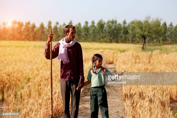 farmer portrait in the wheat field - school cane stock photos and pictures