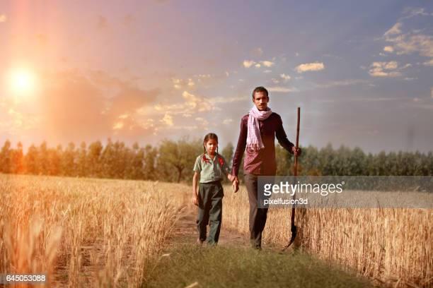 Farmer portrait in the wheat field