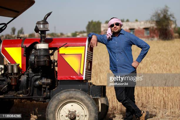 farmer portrait near wheat crop field - prosperity stock photos and pictures