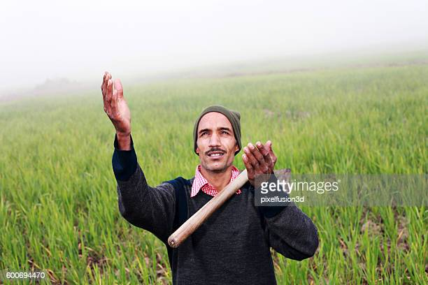 farmer praying to god for wheat crop - place of worship stock pictures, royalty-free photos & images
