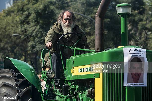 A farmer rides his tractors during a protest by Agricultural Organizations to demand justice for the 43 missing students from Ayotzinapa at Reforma...