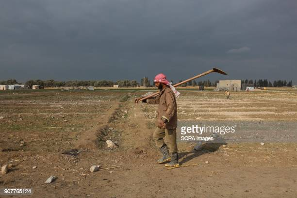 A farmer seen walking while heading to his farm outside Damascus in Ash'ari Despite the ongoing conflict in Syria life in governmentheld parts of...