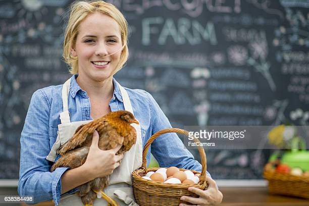 farmer selling eggs at the market - chicken bird stock photos and pictures