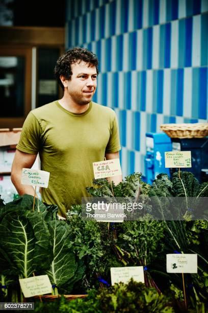 Farmer selling organic produce at farmers market