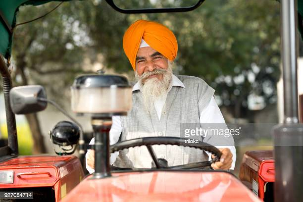 farmer sitting on tractor - punjab india stock pictures, royalty-free photos & images