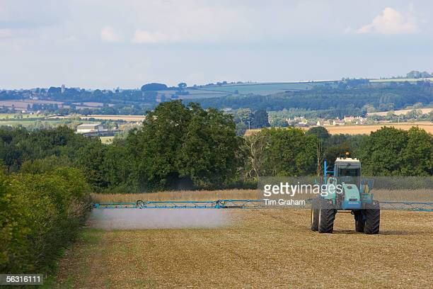 Farmer sprays his crops Oxfordshire United Kingdom