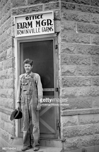 Farmer Standing at Office of Farm Manager, Irwinville Farms Project, Irwinville, Georgia, USA, John Vachon for Farm Security Administration, May 1938.