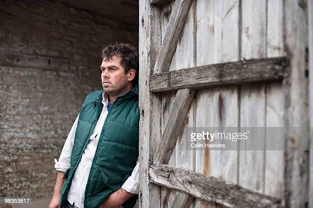 farmer standing in barn