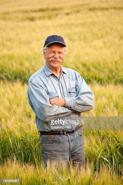 Farmer Standing in crop