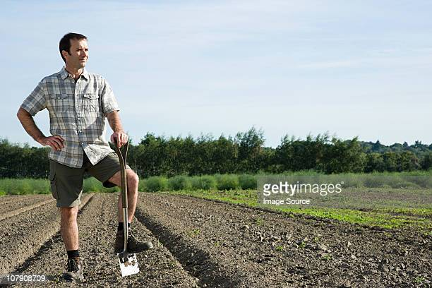 farmer standing in field - esher stock pictures, royalty-free photos & images