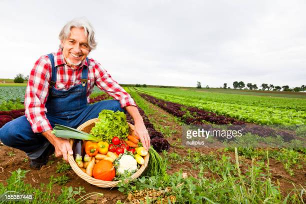 farmer standing in front of his field