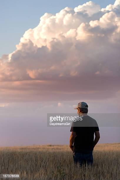 Farmer Standing in Grain Field