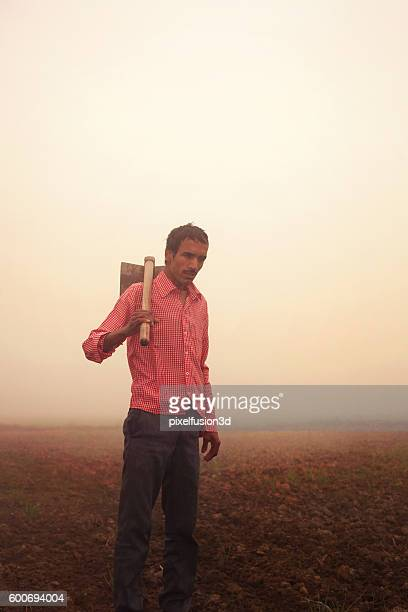 farmer standing in the field - get your hoe ready stock pictures, royalty-free photos & images