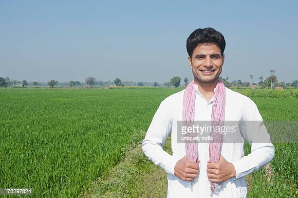 farmer standing in the field, sonipat, haryana, india - haryana stock pictures, royalty-free photos & images