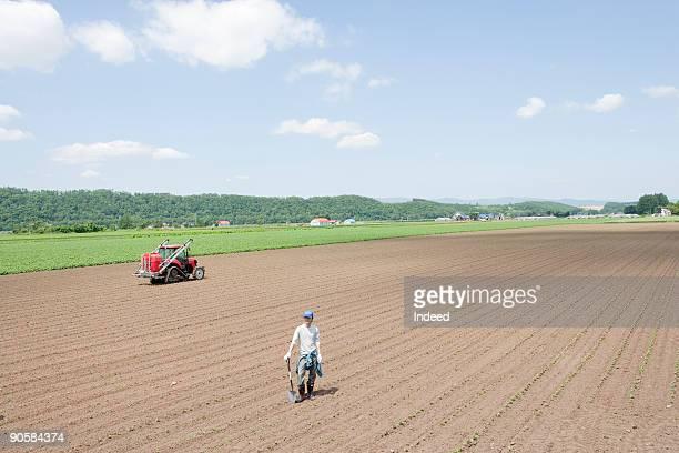 Farmer standing on field