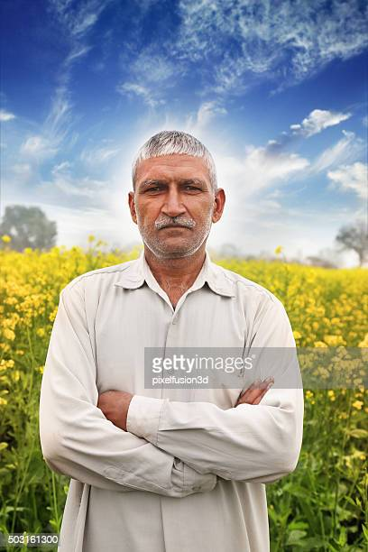farmer standing portrait in near mustard field - kurta stock pictures, royalty-free photos & images