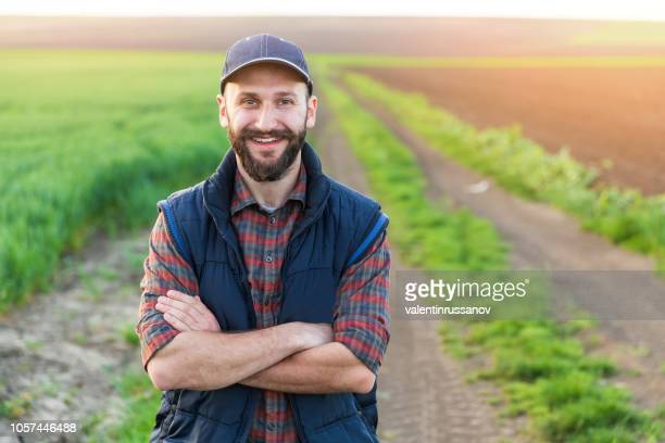 Farmer standing with arms crossed