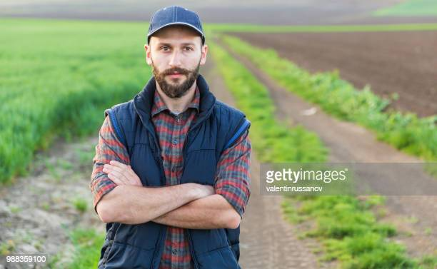farmer standing with arms crossed - agronomist stock pictures, royalty-free photos & images