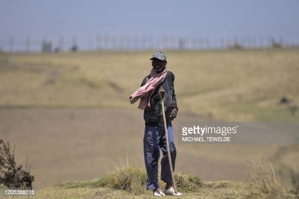 Farmer stands near the site where the Ethiopian Airlines Flight 302 crashed in March 2019, south of Addis Ababa, on March 1, 2020. - Ahead of the...