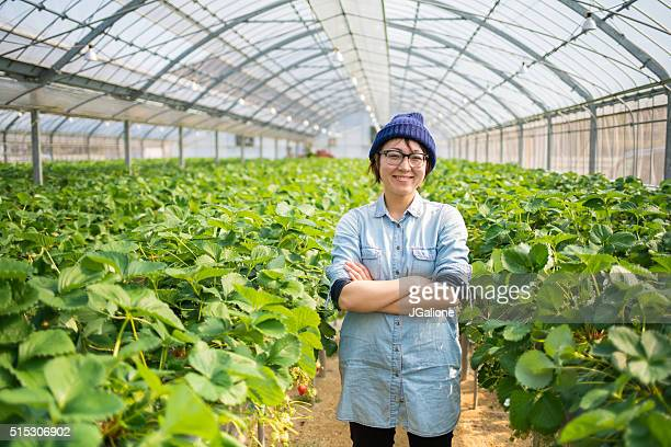 Farmer stood in her greenhouse