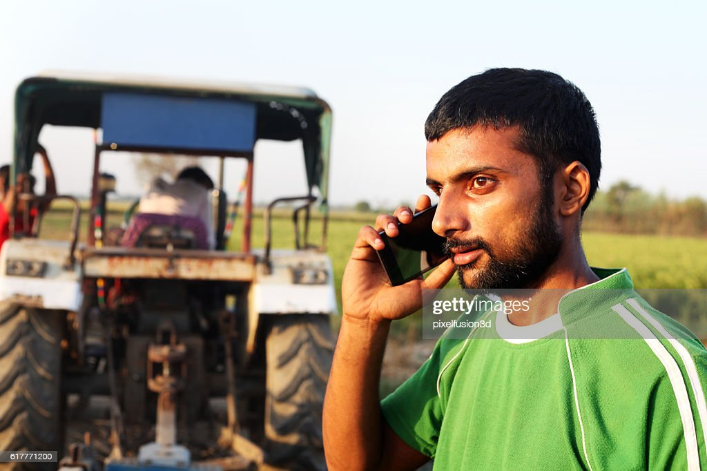 Farmer talking on smart phone : Stock Photo
