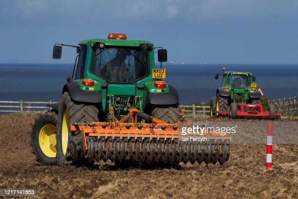 Farmer tills his fields as he continues preparations on the farm for the season ahead on April 06, 2020 in Brotton, United Kingdom. As thousands of...
