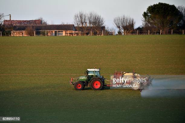A farmer treats a field with pesticide spray next to human habitation on december 10 close to Trébons sur la Grasse southern France GABALDA