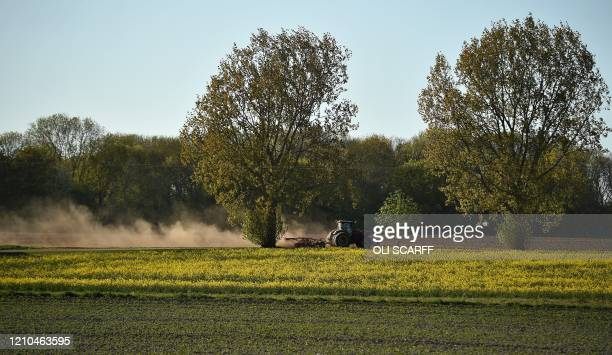 A farmer uses a tractor as he ploughs a field in Retford near Lincoln in eastern England on April 20 as life in Britain continues during the...