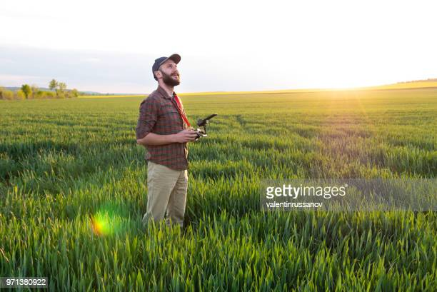 farmer using a drone - agronomist stock pictures, royalty-free photos & images
