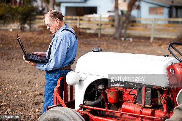 farmer using laptop computer - only senior men stock pictures, royalty-free photos & images