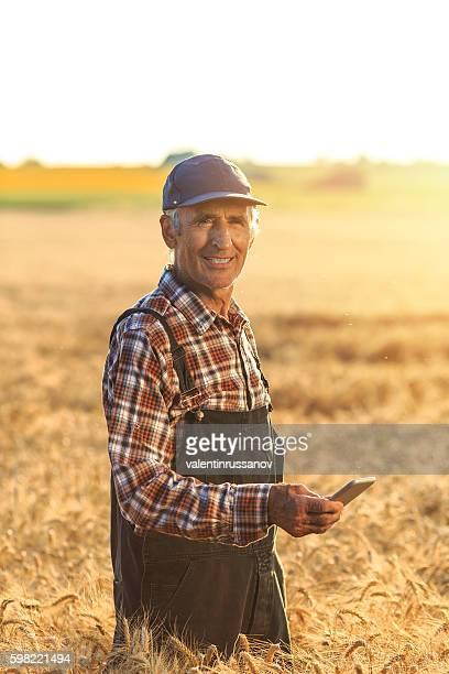 Farmer using smart phone on field