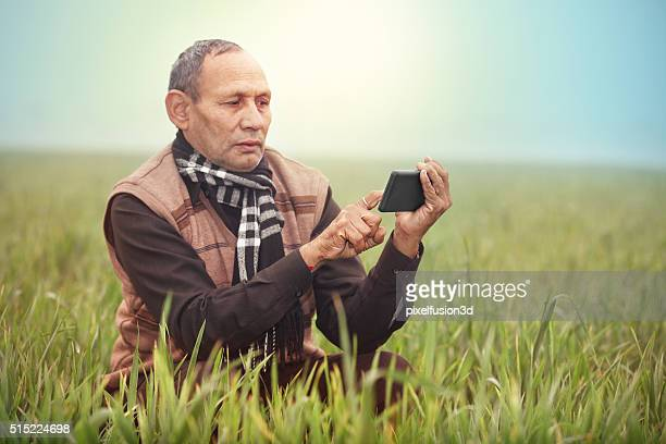 Farmer Using Touch Screen Mobile Phone