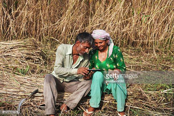 Farmer using touch screen smart phone