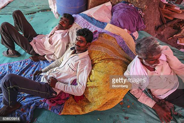 Farmer Vijay Jadhav center and members of his family sit inside a temporary suburban camp set up by local political party Shiv Sena for the rural...