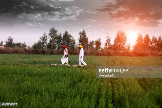 Farmer walking in the field in the morning