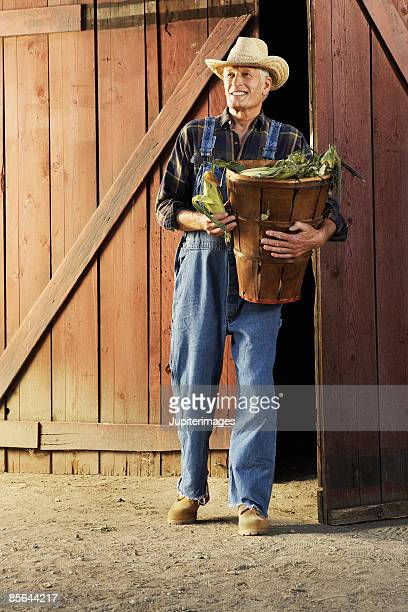 Farmer with basket of corn