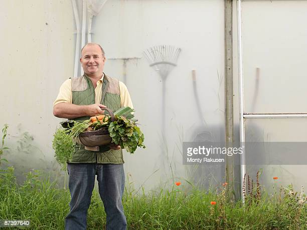 Farmer With Basket Of Vegetables