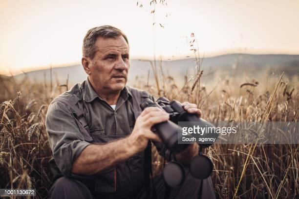 Farmer with binoculars