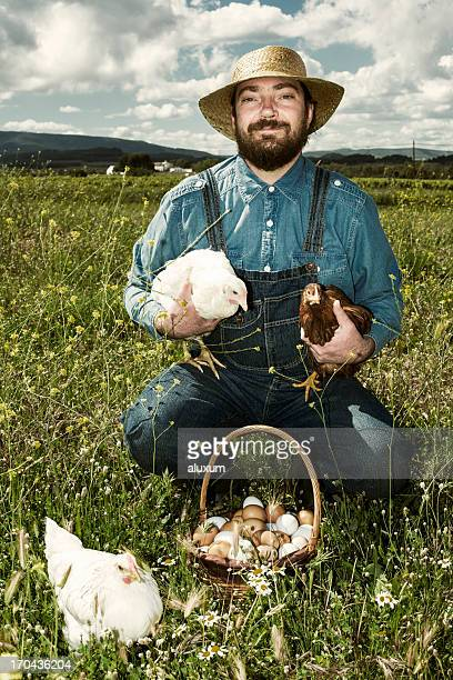 Farmer with chicken and organic eggs