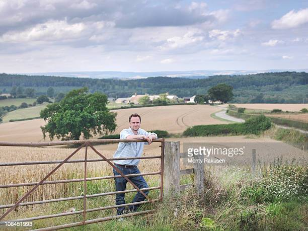 Farmer with crops and farm