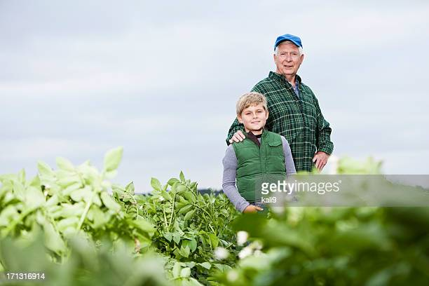 Farmer with grandson in field