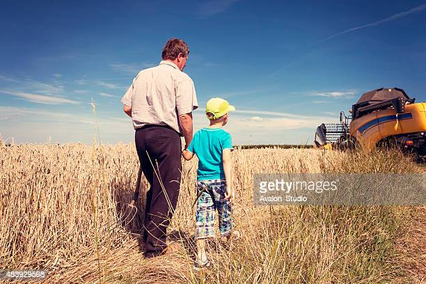 Farmer with his son on the field