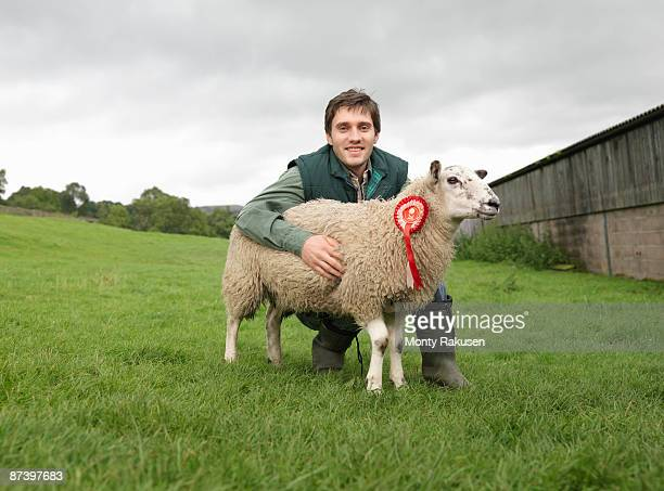 Farmer With Prize-Winning Sheep